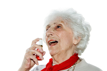 senior demonstrating nitroglycerine spray for heart pain