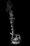 smoking kills concept. Cigarette in skull ashtray. poster