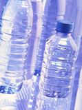 Plastic bottles of different volume with water poster
