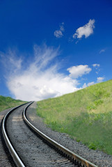 railway and  dark blue sky with white clouds, spring