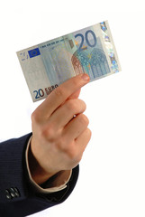 businessman holds  denomination twenty euros