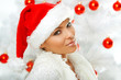 20-25 years olf beautiful woman next to christmas tree