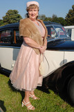 lady in retro vintage costume - Goodwood Revival event, UK poster