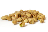 Heap of salty pistachios isolated. Soft focus poster