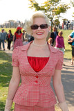 fifties vintage costume at Goodwood Revival event, UK poster
