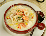 Delicious thick and creamy seafood chowder with seafood. poster