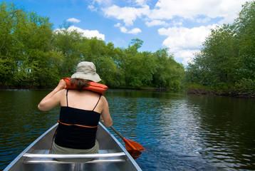 Idyllic canoeing on a gentle stream