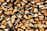 Stack of fresh firewood - wooden abstract background poster
