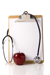 A doctor or nurses clipboard with a stethoscope and a red apple