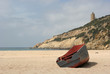 A stranded boat on a deserted beach in Cadiz, South of Spain