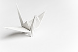 An origami bird on a white background