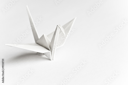 An origami bird on a white background - 9558731
