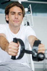 Man working out at the gym looking serious..