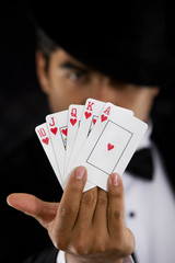 elegant man with Royal Flush Poker Hand - focus on cards