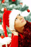 Beautiful young woman wearing santas hat