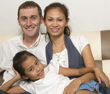 young interracial family with child poster