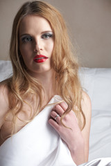 Sensual naked young blonde adult Caucasian woman