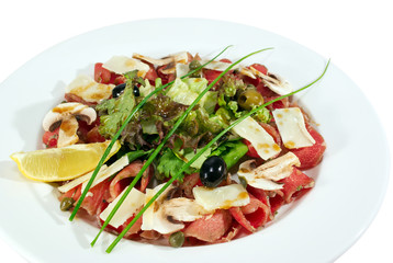 appetizer with fish fillet, olives, mushrooms, salad isolated