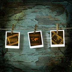 Photos on clothesline against old crackled backdrop