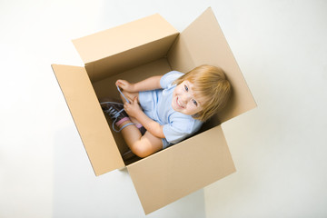 Happy child in box