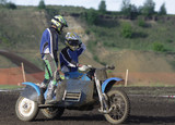 Two motorcyclists aspire to finish on road poster