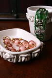 Orange and Green jewelery in a white ceramic bowl poster