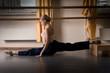 dancer girl is doing exercise on the floor