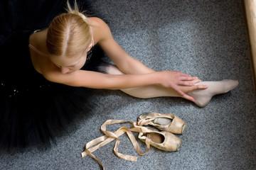 ballerina is relaxing on the floor in the room
