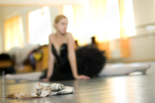 ballerina is relaxing on the floor in the room