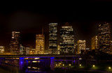 City Skyline at night with highway bridge in foreground poster