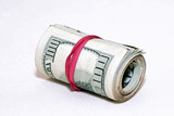 roll of money wrapped with a red elastic laying down poster