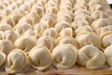 Foodstuff: texture of raw Russian ravioli poster