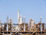 Towers of a refinery of chemistry-chemical industry poster