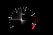 moving revs meter of a sports car on a black background.