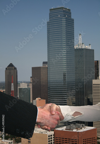 business handshake with Dallas skyline