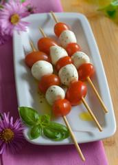 bocconcini mozzarella and cherry tomatos on skewers
