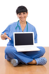 Woman doctor sitting with laptop a over white background