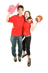 Two enthusiastic teen football fans jumping for joy.  Full body