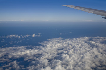 Ocean outside a jumbo jet plane window