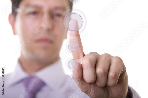 a businessman pressing a hi-tech button