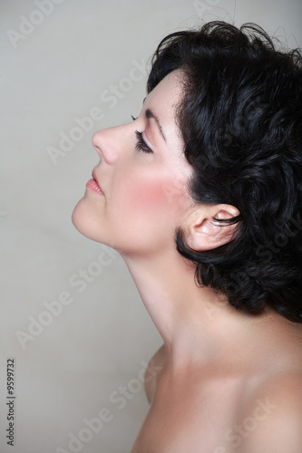 Beautiful woman in her early 40s late 30s with short curly hair