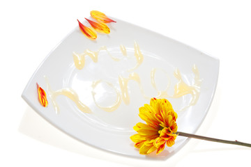 'My honey' text on a white plate, made of honey, isolated
