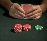 gambling chips  and poker player in Vegas holding cards poster