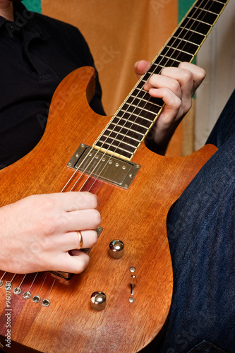 Musician playing  an electric guitar cropped