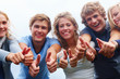 Young teenagers showing thumbs up