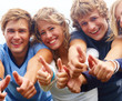 Young teenagers showing thumbs up sign