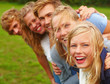 Closeup portrait of happy young teens in a line