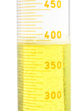 yellow fluid in a large testtube on white background poster