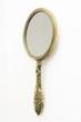 Leinwanddruck Bild - Ornate Antique Art Deco brass hand-mirror. Isolated on white