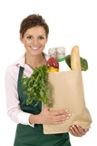 Shop Assistant Holding Grocery Bag poster